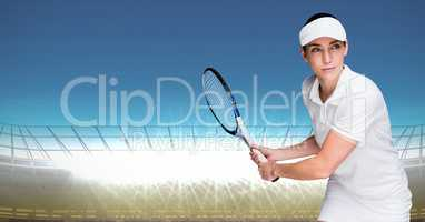Tennis player against bright lights with blue sky