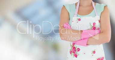 Woman in apron with brushes against blurry window