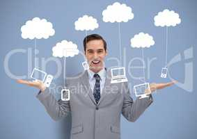 Man deciding or choosing computers phones and tablet devices hanging from clouds with open palms han