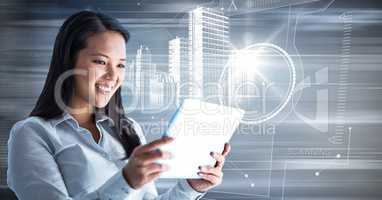 Woman with tablet and white building graphic against motion blur