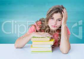 Woman with books at desk against blurry blue wood panel