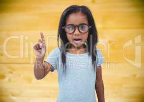Girl in glasses against yellow wood panel