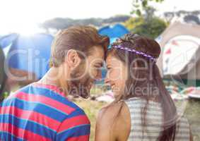 Hippie couple in campsite with flare