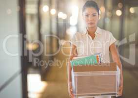Unhappy Woman redundant with box against office