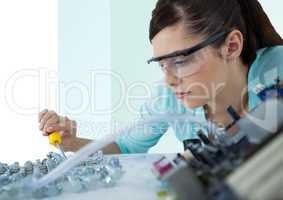 Woman with electronics against green and white background