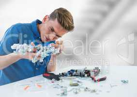 Man with electronics against blurry background