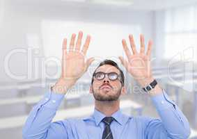 Man with open palm hands in classroom
