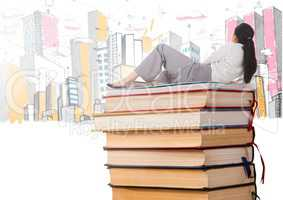 Woman lying on Books stacked by fun buildings drawings