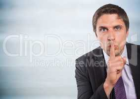 Business man finger over mouth against grey wood panel