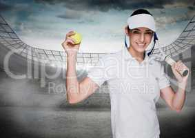 Tennis player against stadium with bright lights and sky with clouds