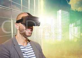 Man in VR with flares and white building graphic against window and evening sky