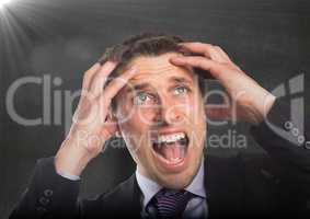 Business man hands on head against concrete wall with flare