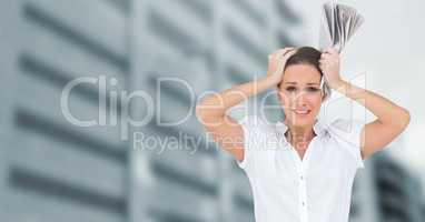 Stressed woman in front of tall buildings