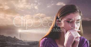Sad woman next to lighthouse and sky