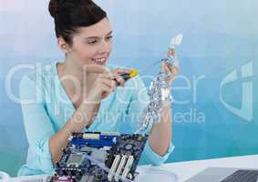 Woman with electronics against blue vector mesh