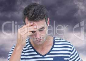 Depressed stressed man against dark clouds