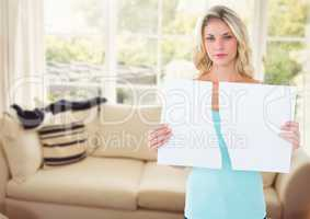 melancholic woman ripping paper in two in sitting room