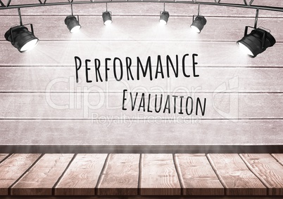 Performance evaluation text with spotlights on wood