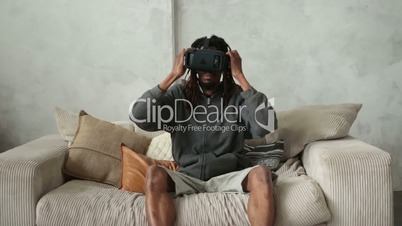 Handsome african hipster putting on VR headset