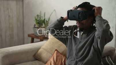 Closeup man putting on virtual reality 3d glasses