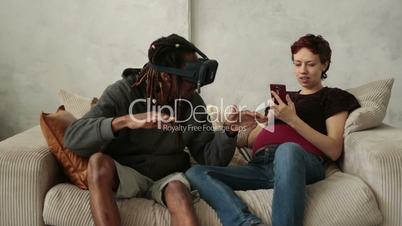 Multiethnic couple using new trends technology