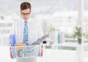 Businessman redundant with belongings in box in office