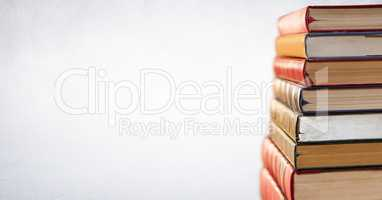 Pile of books against white background