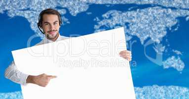 Travel agent with large blank card against map with clouds and blue background