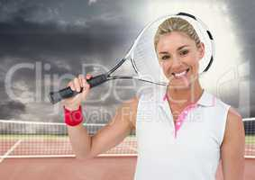Tennis player smiling on tennis court with bright light and dark clouds