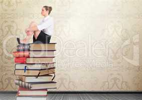 Businesswoman sitting Books stacked by decorative wallpaper antique
