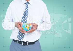 Travel agent mid section holding globe against green map