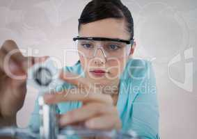 Close up of woman with electronics against white background with interface