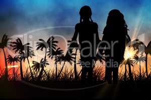Silhouettes of  kids holding hands against sunset view with palm trees