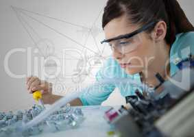 Woman with electronics against white background with graphs