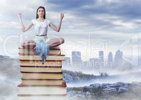Woman meditating sitting meditating on Books stacked by distant city