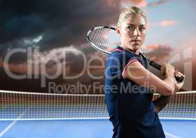 Tennis player on court with evening sky