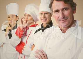 Four chefs against cream background