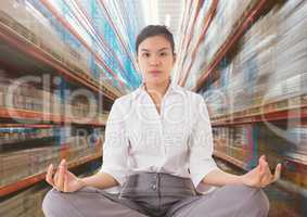 Businesswoman Meditating against motion blur background