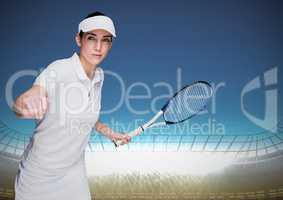 Tennis player in stadium with bright lights and blue sky