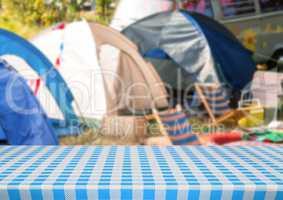 Picnic table against blurry campsite