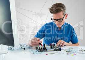 Man with electronics against white background with graphs