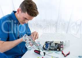Man with electronics against blurry window