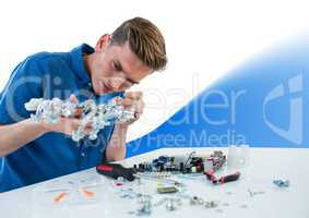 Man with electronics against white background with blue wave