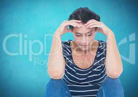 Depressed stressed woman against blue background