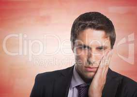 Business man hand on face against blurry red wood panel