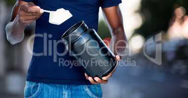 Man taking supplement against blurry street scene