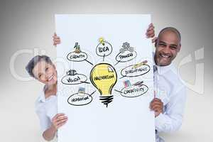Happy business people holding card with illustration of innovation process