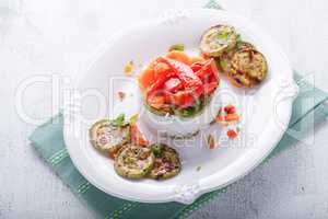 Rice timbale with fried zucchini, peppers, carrots