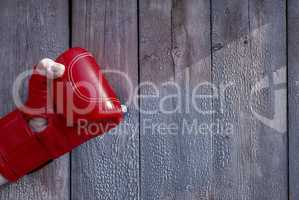 Right man's hand in red boxing gloves