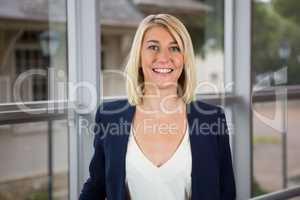 Beautiful businesswoman standing in conference centre
